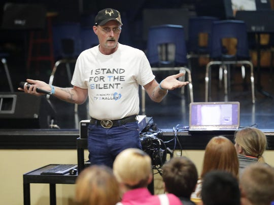 Kirk Smalley talks to eighth graders during a Stand for the Silent anti-bullying presentation at Washington Middle School on Monday in Green Bay.