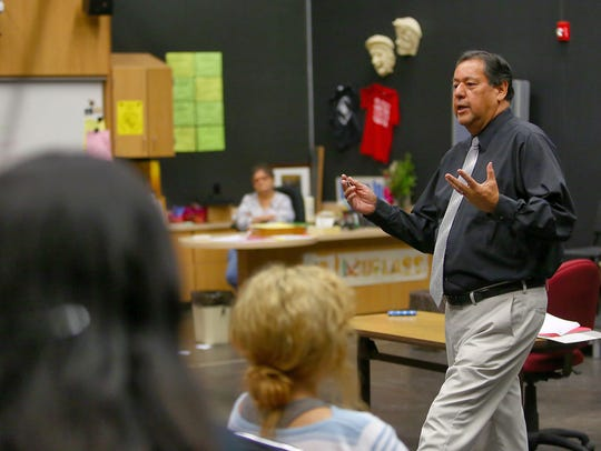 Rudy Ramirez talks with a theater class in the new