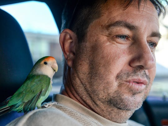 Mark Briggs of Florida reunites with his Little Tony bird in Liberty on Wednesday.