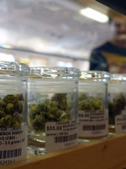 Jars of marijuana sit away customers at Harborside