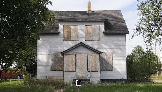 An abandoned home shown the summer of 2014.