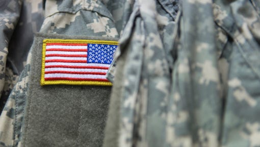 A stock image of U.S. Army uniforms.