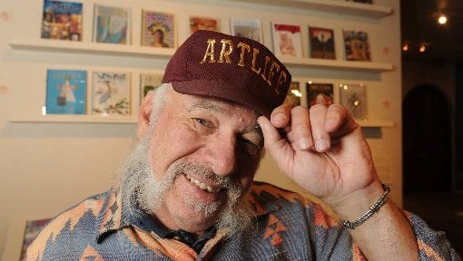 Ventura artist Joe Cardella wears a cap bearing the name of his publication, ARTLIFE.