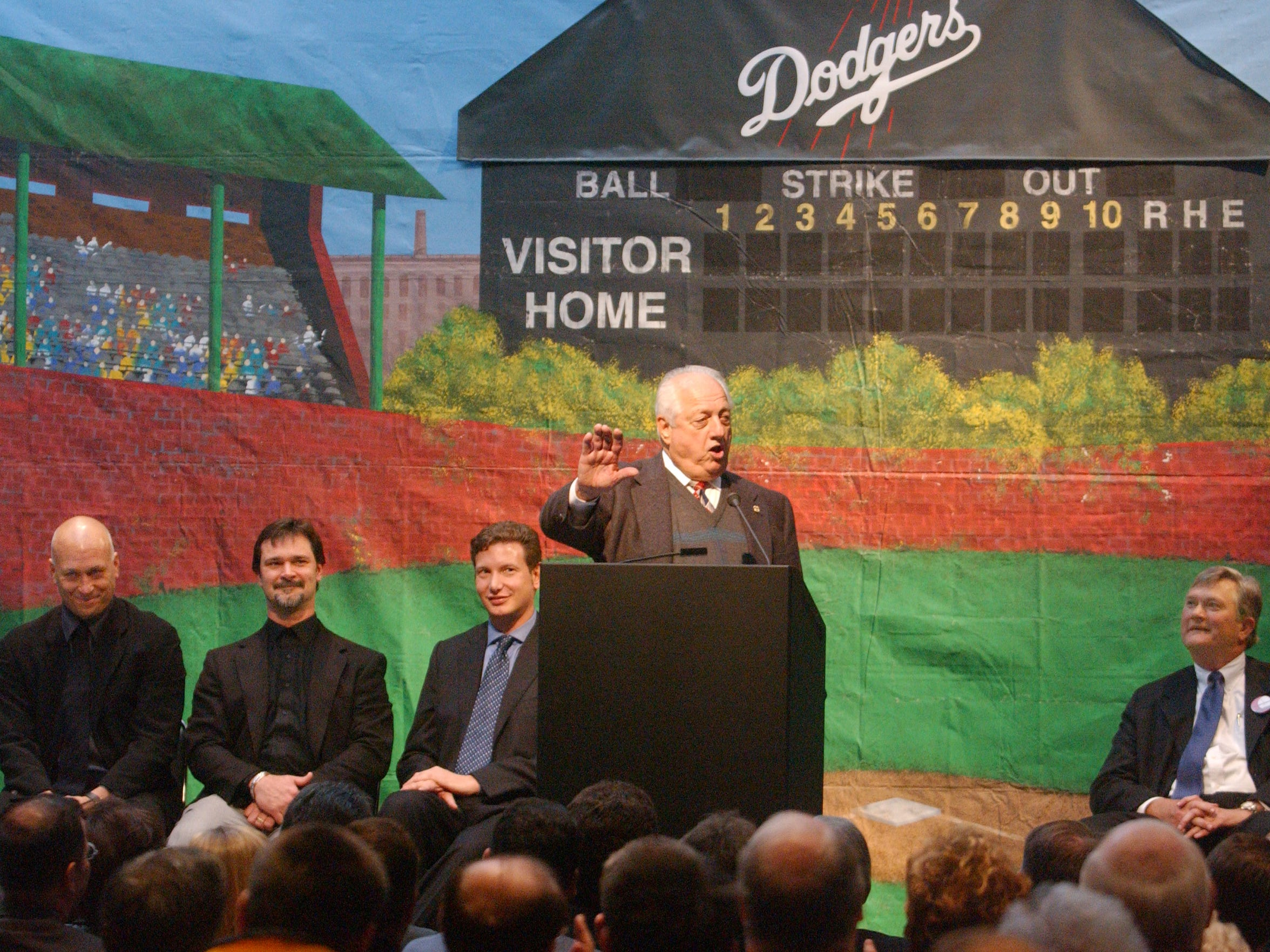 Tommy Lasorda entertains the crowd during a large press conference at the Centre in Evansville in 2003. The South Georgia Waves are expected to move to Evansville.  From left, Cal Ripken Jr., Don Mattingly, Dave Heller, Tommy Lasorda and Niel Ellerbrook.