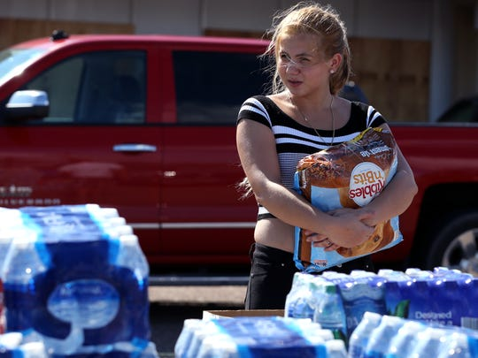 Didnaisy Alvarez, 15, waits for her mom to go through donations for things her family can use on Tuesday, August 29, 2017 in Rockport, TX. Aransas Pass had catastrophic damage from Hurricane Harvey. Volunteers brought in a variety of items from San Antonio.