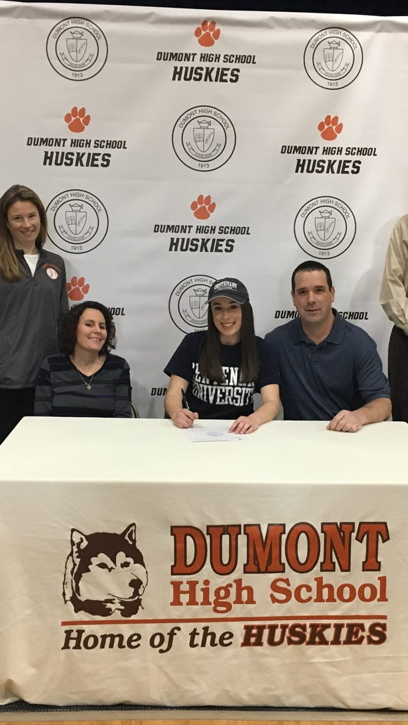 Courtney Deloughery will play softball at Centenary College in Hackettstown. From left: Softball coach Kendal George; Deloughery's mother, Jennifer; Courtney Deloughery; her father, Barry; and Athletic Director Michael Oppido.