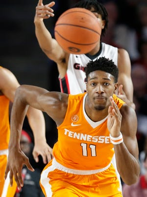Tennessee forward Kyle Alexander (11) runs after a loose ball in a game against Georgia on Saturday.