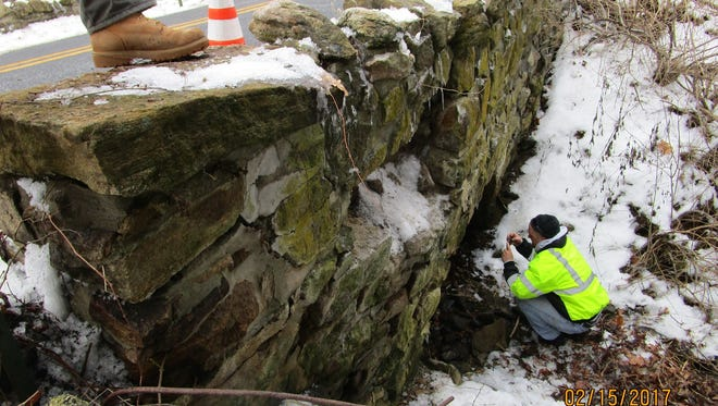 Engineers inspect a bridge on Hardscrabble Road, which runs along the border of Mendham township and borough.