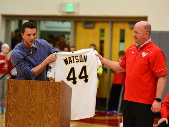 Pittsburgh Pirate Tony Watson, a DCG graduate, presents DCG principal Cary Justmann with his Pittsburgh Pirate jersey on Friday, January 29, 2016, at Dallas Center-Grimes High School during a basketball game between the Newton Cardinals and the Dallas Center-Grimes Mustangs.