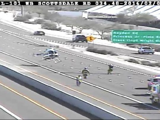 A medical helicopter landed on L-101 near Scottsdale to transport victim.