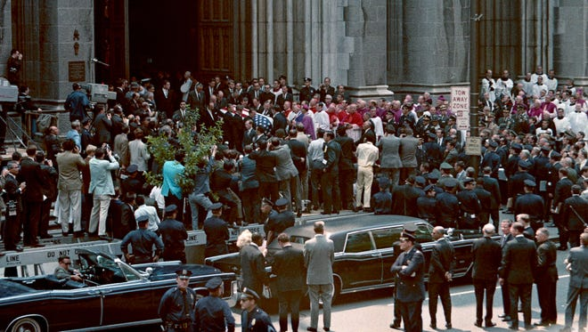 Mourners pour into St. Patrick's Cathedral on June 7, 1968, to pay their respects and view the body of Robert F. Kennedy. Kennedy was murdered on June 5, 1968, in Los Angeles. An estimated 100,000 people filed through St. Patrick's to pay their respects.