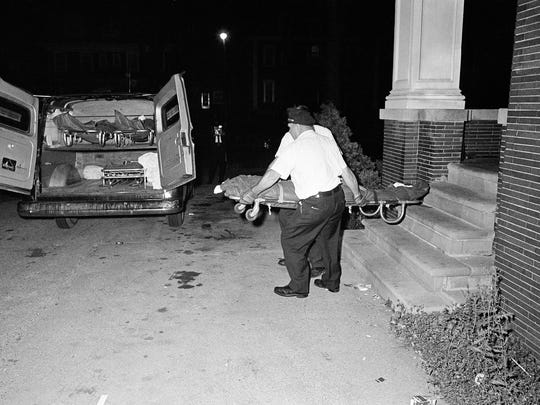 The bodies of three shooting victims are removed from the Algiers Motel in midtown Detroit, July 26, 1967. The three black men were found shot to death in a room of the motel.