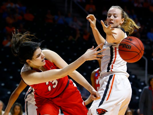 Western Kentucky guard Malaka Frank (13) saves the ball from going out of bounds as as Oregon State center Marie Gulich (21) defends in the first half of a first-round game in the NCAA women's college basketball tournament, Friday, March 16, 2018, in Knoxville, Tenn. (AP Photo/Wade Payne)
