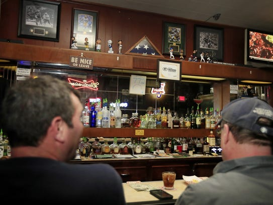 Customers sit at the bar at Lenny's Tap on a recent