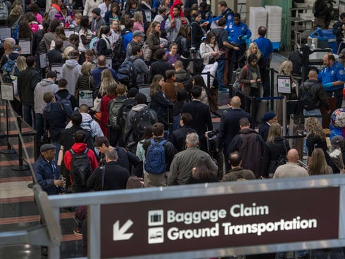 Holiday travelers line up for one of the TSA security checkpoints at Ronald Reagan National Airport Tuesday.