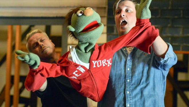 "Hans Friedrichs, left, and Patrick Hunter operate a puppet, Nicky, during the Barn Theatre's rehearsal for ""Avenue Q."""