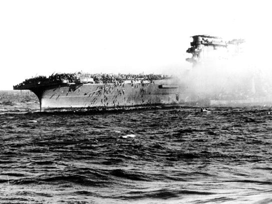 In this file photo, crewmembers abandon the USS Lexington after it was attacked by Japanese forces in the Battle of the Coral Sea. The ship was later deliberately sunk by the US Navy.