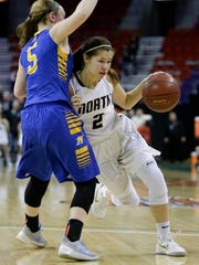 Appleton North High School's Kari Brekke (2) drives past Mukwonago High School's Grace Beyer (5) during the Division 1 championship game at the WIAA state girls basketball tournament Saturday, Mar. 10, 2018, at the Resch Center in Ashwaubenon, Wis.