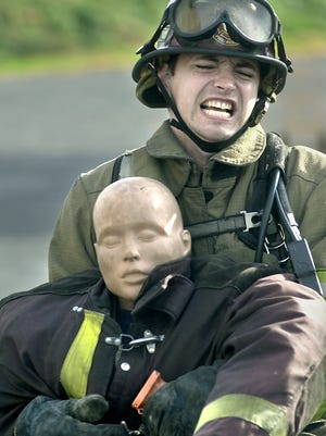 York City firefighter Ivan Flanscha pulls a 175-pound mannequin at the York County Fire School in this file photo while practicing for the Firefighter Combat Challenge in Memphis, Tennessee.