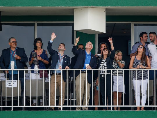 Vice President Mike Pence, alongside wife Karen, gives the thumbs up to the Indiana National Guard during pre-race festivities at the 101st running of the Indy 500 at Indianapolis Motor Speedway on Sunday, May 28, 2017.