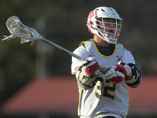 Shane Shively and Leon's lacrosse team practices on