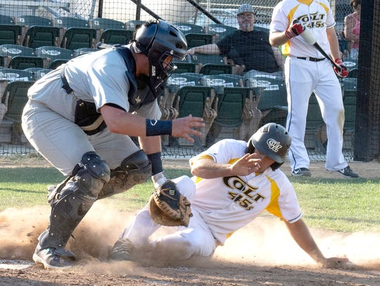 Derick Kuhn of the Redding Colt 45s is forced out at