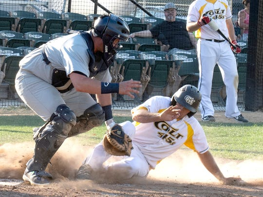 Derick Kuhn of the Redding Colt 45s is forced out at home as Humboldt B52s catcher Jeff Giacomini takes the throw Sunday at Tiger Field.