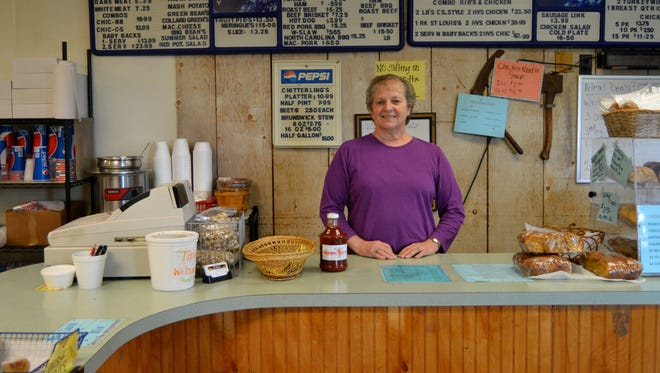 Robin Emig, owner of EM-INGS in Bishopville, stands behind the counter.