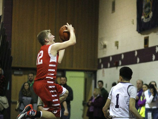 Waverly's Hunter Bodine goes up for a layup over Dryden