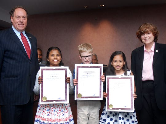 Union County Freeholder Chairman Bruce H. Bergen and Freeholder Bette Jane Kowalski present resolutions to the 4th grade winners of the 2017 Union County Arbor Day Poetry Contest. Bianca Barreto from St. Bartholomew Academy in Scotch Plains won first place, Phillip Snair from School One in Scotch Plains won second place and Anna Maliakal from Holy Trinity in Westfield won third place.