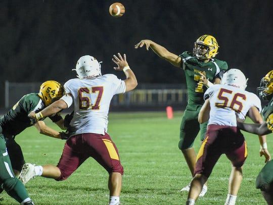 Hoover Quarterback Bryon Jarrett (7) makes a pass as