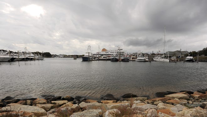 Dark clouds fill the skies over Hyannis Harbor and the thoughts of many poets writing for this month's Cape Cod Poetry page.
