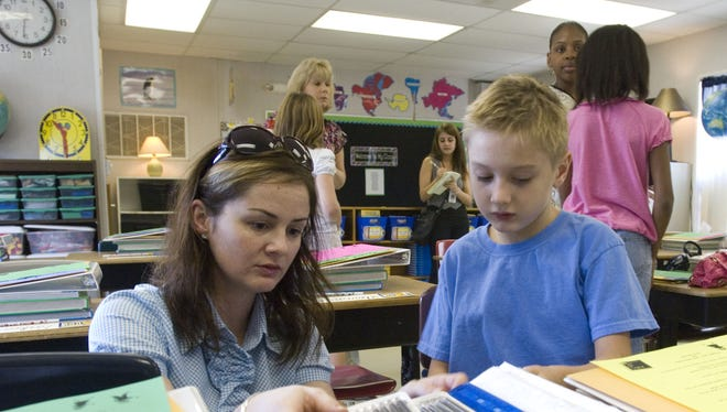Anne McLendon, left, and her son James Remski, right, attend an orientation at Cordova Park Elementary School.