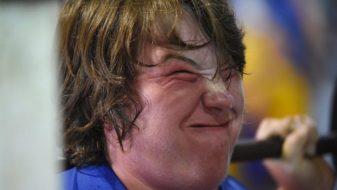 Bomber football player Gabe Henderson grimaces as he lifts weights Tuesday. The team is hitting the weight room up to four times a week on a voluntary basis.