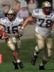 Matt Light (78) protects Drew Brees as he runs up the field early in the game against Northwestern in 2000.