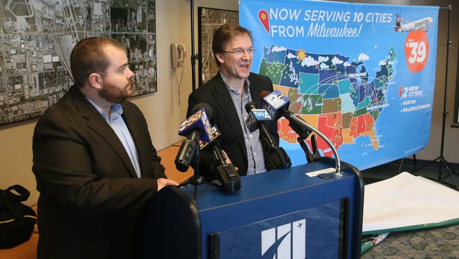 Frontier Airlines, director of planning and commercial analysis, Seth Neuschwander (left) announced new flights to Austin and Raleigh-Durham from $39.00 from Milwaukee's General Mitchell International Airport, as Milwaukee County Executive Chris Abele looked on (right).