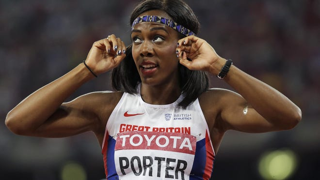 Britain's Tiffany Porter looks at the results from the women's 100m hurdles final at the World Athletics Championships at the Bird's Nest stadium in Beijing, Friday, Aug. 28, 2015. (AP Photo/David J. Phillip)