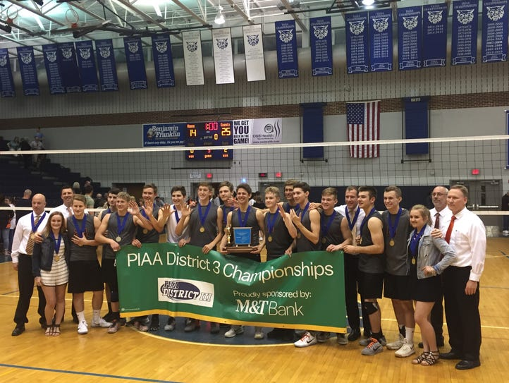 The Northeastern boys' volleyball team poses with the