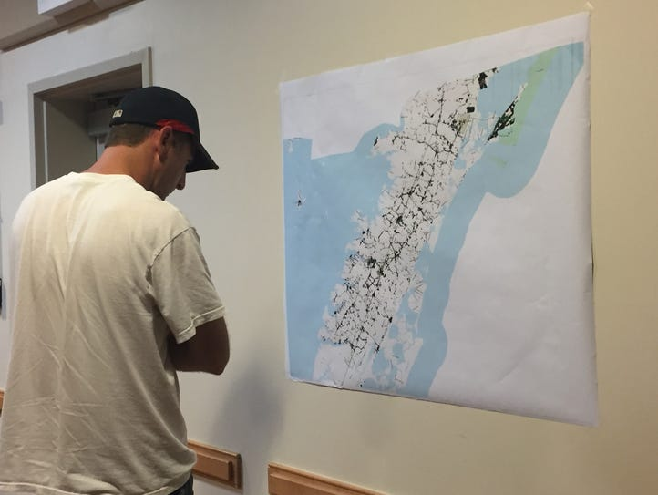 A man looks at a map showing where the Eastern Shore