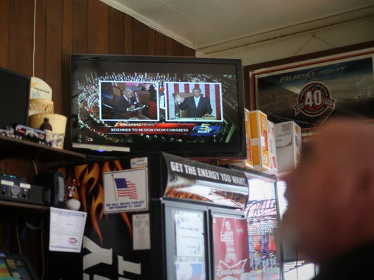A news story about John Boehner resigning plays on the television at Andy's Cafe in Carthage, the bar that Boehner's father owned and whose floors John Boehner famously swept as a youngster.
