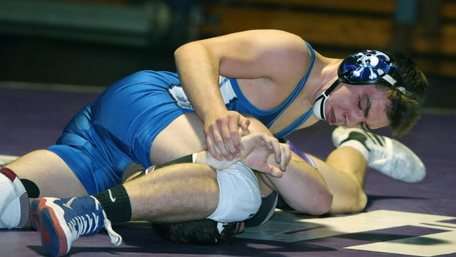 Pearl River's Sean McGarvey defeated John Jay's Josh Rubin in the 145-pound weight class during wrestling action at John Jay High School in Cross River Jan. 11, 2017.