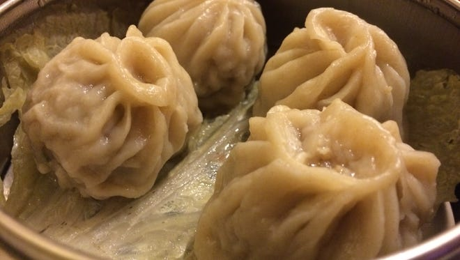 "A dish described as, ""steamed juicy pork bun,"" on DJ Chinese's dim sum menu, is a form of pork dumplings."