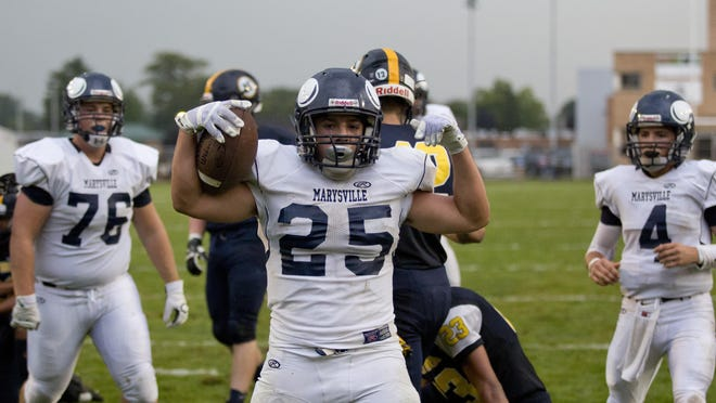 Marysville's Dante Chrcek celebrates scoring a touchdown during a football game last year at Memorial Stadium against Port Huron Northern.
