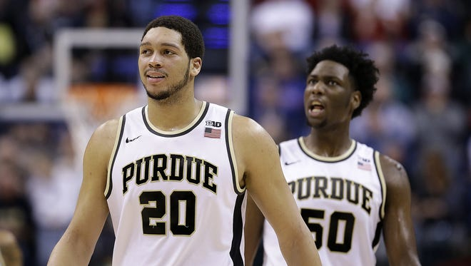 Purdue Boilermakers center A.J. Hammons (20) cracks a smile with Caleb Swanigan (50) late in the second half of their Big Ten Men's Basketball Tournament semifinal game Saturday, Mar 12, 2016, afternoon at Bankers Life Fieldhouse. The Purdue Boilermakers defeated the Michigan Wolverines 76-59.