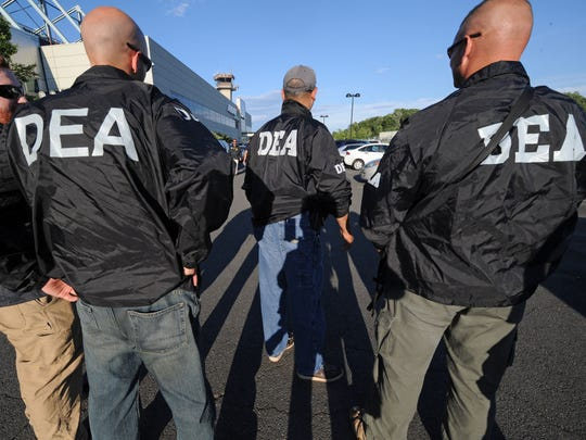 Scammers now are pretending your ID showed up at a drug bust, and then they ask you to verify your Social Security number to clear up the matter. File photo: DEA Agents, Associated Press.
