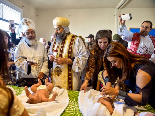 Father Girgis Ramandious, left, and His Grace Bishop Karas, center, pray over two newly baptized girls during the first Coptic Orthodox service in the old Trinity United Methodist building owned by Bethlehem UMC in Dallastown Saturday, Feb. 3, 2018. York County's growing Egyptian Coptic Christian community had previously used St. Mary's Catholic Church in York for their services, studies and other customs, and are now leasing the old Trinity building from Bethlehem UMC. The Copts, now numbering about 80 families, still hope to find a larger, more permanent church closer to their homes in York.