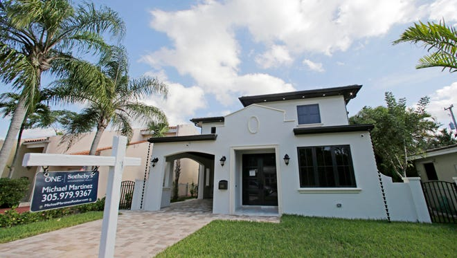 This Tuesday, Dec. 6, 2016, photo, shows a house for sale in Coral Gables, Fla. Long-term U.S. mortgage rates climbed for the sixth straight week in the aftermath of Donald Trump's election win, marking new highs for the year, according to information released Thursday, Dec. 8, by Freddie Mac.
