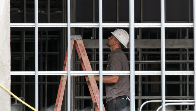 A Hanco Corporation General Contractors employee prepares to work on the internal structure of the College of Business building in Hattiesburg.