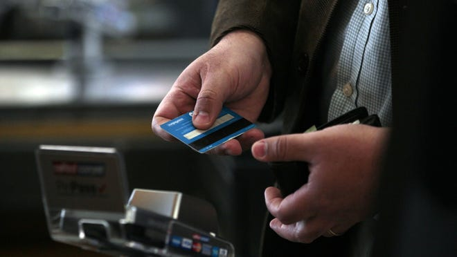 A man pays with a credit card in a Wal-Mart Ekono supermarket in Santiago, Chile. Some people make a hobby of juggling multiple credit cards to maximize rewards; others just want simplicity. If the idea of chasing credit card rewards as a pastime doesn't appeal to you, using just one credit card is a reasonable choice.