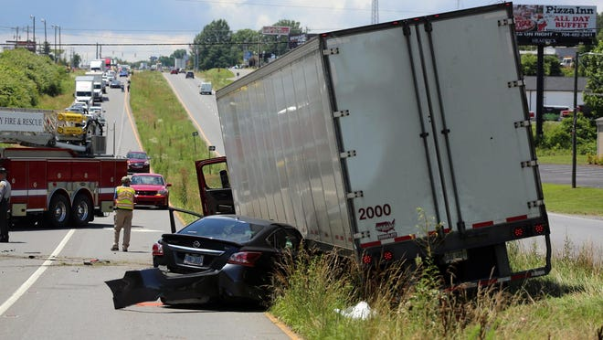 The eastbound lane of U.S. 74 backs up with traffic after two cars and a semi truck were involved in a wreck near Cleveland Mall on Thursday. Two people were transported to the hospital with unknown injuries.